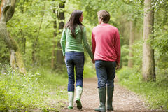 Couple walking on path holding hands Royalty Free Stock Image