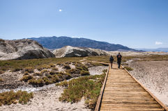 Couple walking. On a path in a national park, death valley, USA Stock Photos