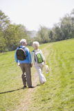 Couple walking on path in park holding hands Stock Photos