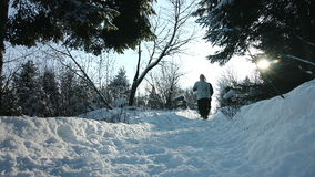Couple Walking on a Path together during Day of Winter stock footage