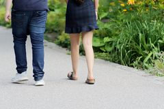 Couple walking on pedestrian way in a park. Hamburg, Germany stock photography