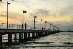 Couple walking on pier Stock Photos