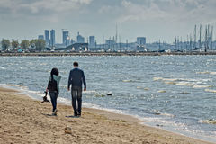 Couple Walking On The Pirita Beach Stock Photo