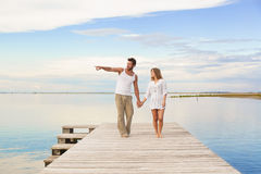 Couple walking and pointing to the horizon Royalty Free Stock Photography