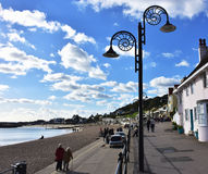 Couple walking on promenade in sea town . Royalty Free Stock Images