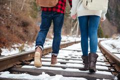 Couple walking on railway Royalty Free Stock Photos