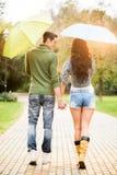 Couple Walking In The Rain Stock Photo
