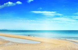 Couple walking relaxing on  beach Huahin Stock Photography