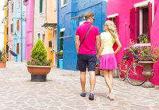 Couple walking in romantic village Stock Images
