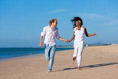 Couple walking and running on beach Royalty Free Stock Photo