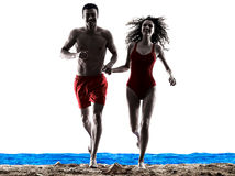 Couple walking running on the beach Royalty Free Stock Image