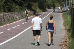 Couple walking after running Stock Photo