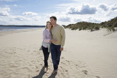 Couple Walking On Sandy Beach Stock Photography