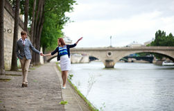 Couple is walking by the Seine Royalty Free Stock Photography