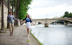 Couple is walking by the Seine Stock Image