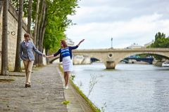 Couple is walking by the Seine Stock Images