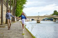 Couple is walking by the Seine Royalty Free Stock Photo