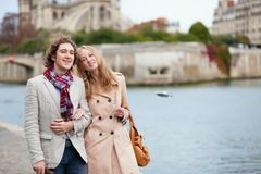 Couple walking by the Seine in Paris Stock Photography