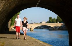 Couple walking by the Seine Stock Photos