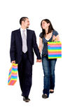 Couple walking, shopping bags Stock Images