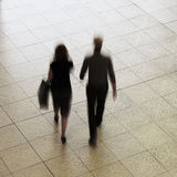 Couple walking in shopping mall Royalty Free Stock Image