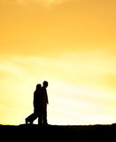 Couple walking silhouette Royalty Free Stock Photography