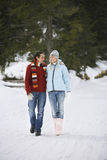 Couple Walking On Snow Covered Path Stock Images