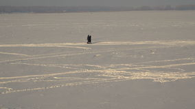 Couple walking in the snow stock footage