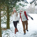 Couple walking through snow Stock Image