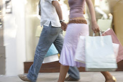 Couple Walking by Store Stock Images