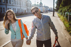 Couple walking in the street on a summer day Royalty Free Stock Photography