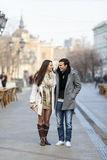 Couple walking on the street Royalty Free Stock Photos