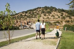 Couple walking in suburban development. On a summer day stock photo