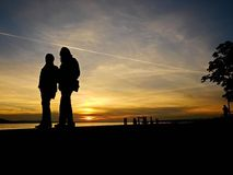 Couple walking sunset Royalty Free Stock Photo