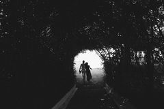 Free Couple Walking Through The Tunnel Of Trees Royalty Free Stock Photos - 59725488