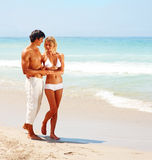 Couple walking together at the beach Stock Image