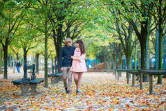 Couple walking together on a fall day in Paris Royalty Free Stock Image