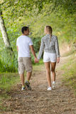 Couple walking together outdoor in countryside Royalty Free Stock Photo