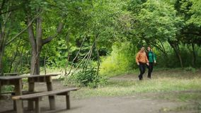 Couple Walking Together In Park. Young couple enjoying time together in nature park stock video