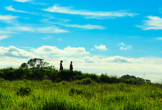 A couple walking on top of the hill Stock Photography