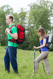 Couple walking with tourist backpacks Royalty Free Stock Photography