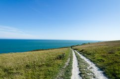 Couple walking towards the sea. Footpath on the White Cliffs of Dover, England Stock Images