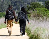 Couple Walking A Trail. Through Anyo Nuevo California State Reserve Royalty Free Stock Image