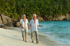 Couple walking on  tropical beach Stock Photography