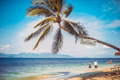 Couple walking on tropical beach scenery of Koh Samui. Stock Photography