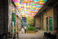 Couple walking under the decorated roof, umbrella. Royalty Free Stock Image