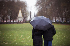 Couple walking under the rain Stock Photography