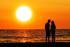 Couple walking under the sunset. Silhouette of a couple walking under sunset at the Beach of Scheveningen, Netherlands Stock Photography