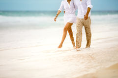 Couple walking through the waves Stock Image