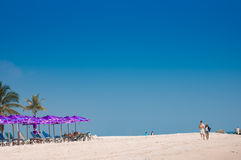 Couple walking on the white sand beach, Hua Hin. Stock Photos